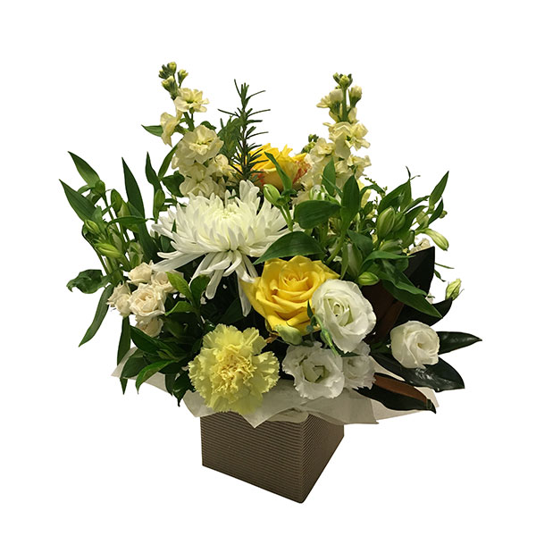 Box of cheerful warm yellow flowers